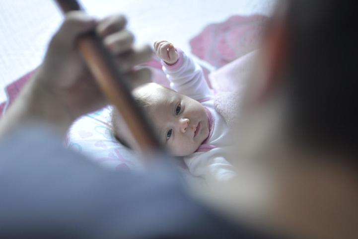 Baby watching daddy play and instrument